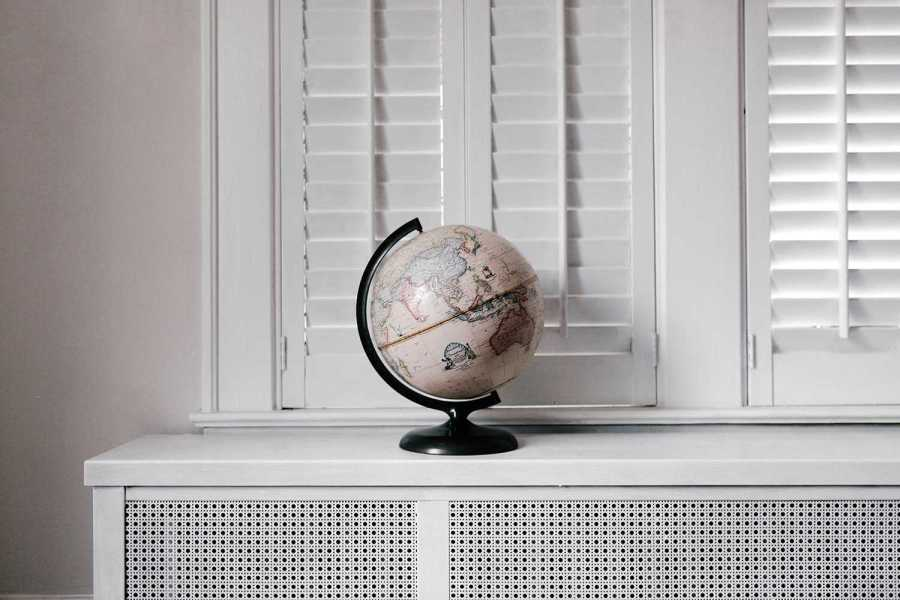 Globe sitting on a counter in front of a window
